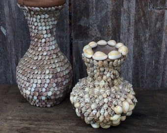 Pair of seashell covered clay vases