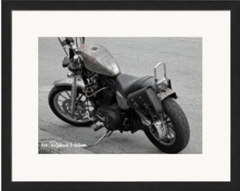 Old motorcyle black and white photographic print.  Personally photographed.