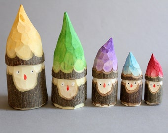Little elves, hand carved from green, local wood
