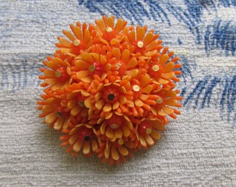 Mid-century round two-tone orange plastic flowers brooch, bead centres