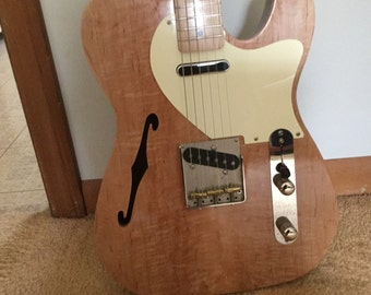 Custom electric guitar: Hand-carved hand made custom Telecaster electric guitar with f-hole crafted by luthier, Al Rutman, flame maple body