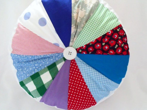 "round patchwork sprocket cushion,  pinwheel scatter cushion, large and comfy accent pillow, 13"" across, multicoloured"