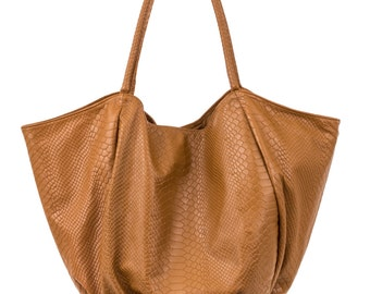 Shopping Lambskin leather handbag Printed in a snake pattern made in France.