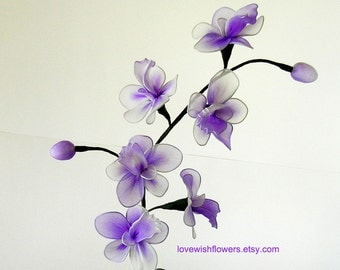 Purple Dendrobium orchids is holiday gift. For home decor. Handcraft by nylon fabric flower and leave. Floral arrangement