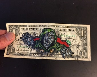 Dr. Doom painted on a dollar