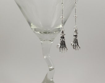 Skeleton hand with skulls long silver earrings
