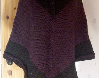 Dark hooded poncho