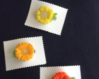 Felt flower primrose style hair clip in yellows/orange