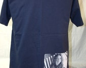 """Widespread Panic Mikey Houser t shirt in navy blue. Lyric on the back is taken from """"May Your Glass be Filled."""""""