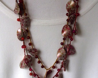 Metal free necklace, multi strands shades of orange and brown muted tones,