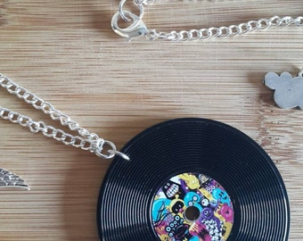 Vinyl Record Necklace. 24 inch silver plated chain. Double-sided record