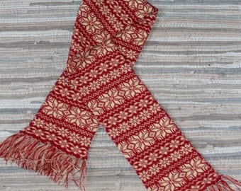 Hand made knitted scarf with ornament and fringe