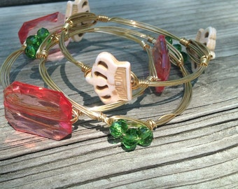 Gold wire bangle with green beads