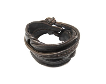 Stitched brown leather hand strap. Brown leather bracelet