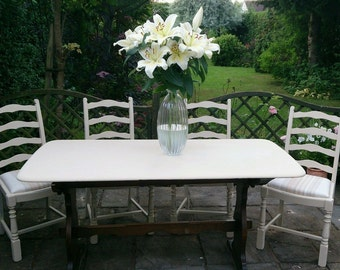 Vintage dining table and four chairs, cream and pastel shades
