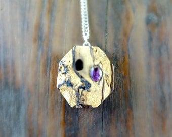 Necklace with violet gem