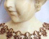 Renoir Mid-Century Copper Necklace: Oval Swirl