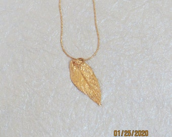 Beautiful gold necklace with gold plated leaf pendant
