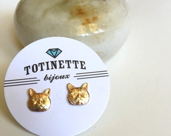Tiny cat head stud earrings