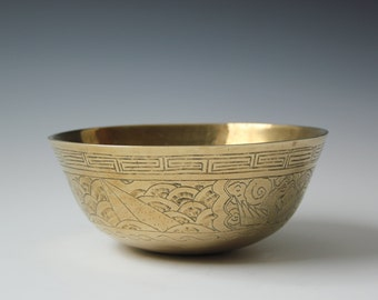 Antique Chinese incised solid brass bowl with birds and cloud pattern