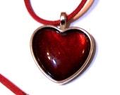 deep red heart pendant on velvet cord