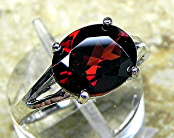 AAA Natural untreated Red Pyrope Garnet 10x8mm  2.70 carat in a 14K white gold ring