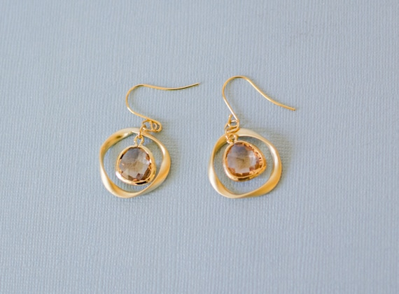 Gold teardrop earrings, peach, ring, unique, organic, circle, universe, nature-inspired jewelry, handmade in Santa Cruz