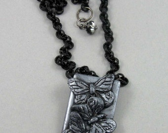 Silver Butterfly Trio Necklace, polymer clay pendant on matte black brass chain, adjustable length, insect jewelry