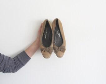 tan suede ferragamo flats . bow tie ribbon . kitten heel .size 7.5 8B .sale