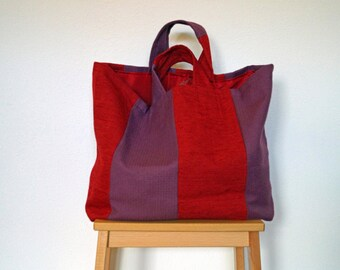 Red and purple fabric tote bag
