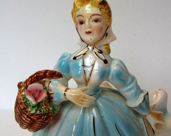 Pretty Vintage Planter Figurine Woman With Dress and a Basket of Flowers