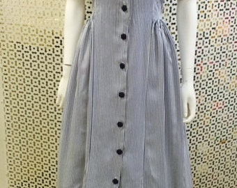 White and navy striped 1950's cotton dress, with pretty side pleating.