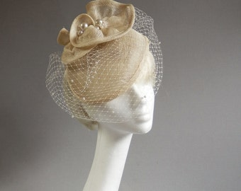 Dutch design creme hat with many many pearl beads included but optiona birdcage veil on comb