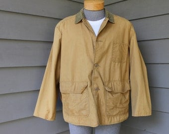 vintage 50's - 60's  -no name- Men's Hunting jacket w/ game pouch. Corduroy trimmed canvas duck. Medium - Large