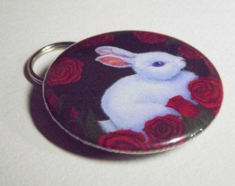 White Rabbit bottle opener key ring, printed with my Alice in Wonderland themed artwork, 'White Rabbit, Red Roses'.