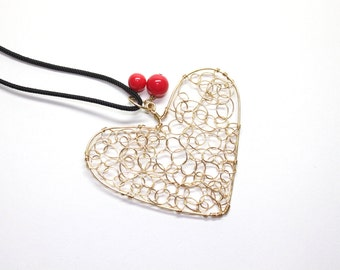 Wire heart pendant with gold tone wire and red glass beads, curlicue wire wrapped heart pendant, paracord optional