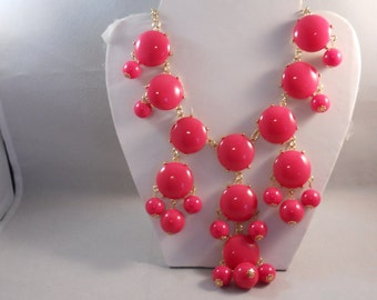 Bib Necklace with Deep Pink Bead Pendants in Gold Tone Frames on a Gold Tone Chain