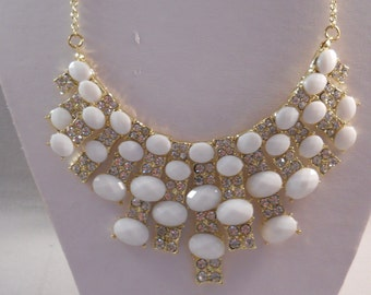 Gold Tone Bib Necklace with White Beads and Clear Rhinestone Pendants on a Gold Tone Chain