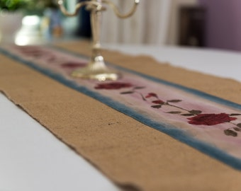 Table runner made from burlap/hessian with rose appliqued. Looks and feels vintage.