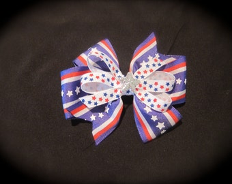 4 inch 4th of July inspired hair bow with a star embellishment