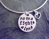 No One Fights Alone bangle for cancer awareness