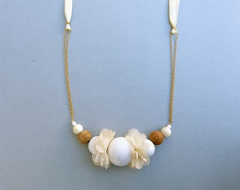 Summer necklace - acrylic wood fabric mother of a pearl - gold plated chain and beige ribbon - adjustable closes whit a knot behind neck