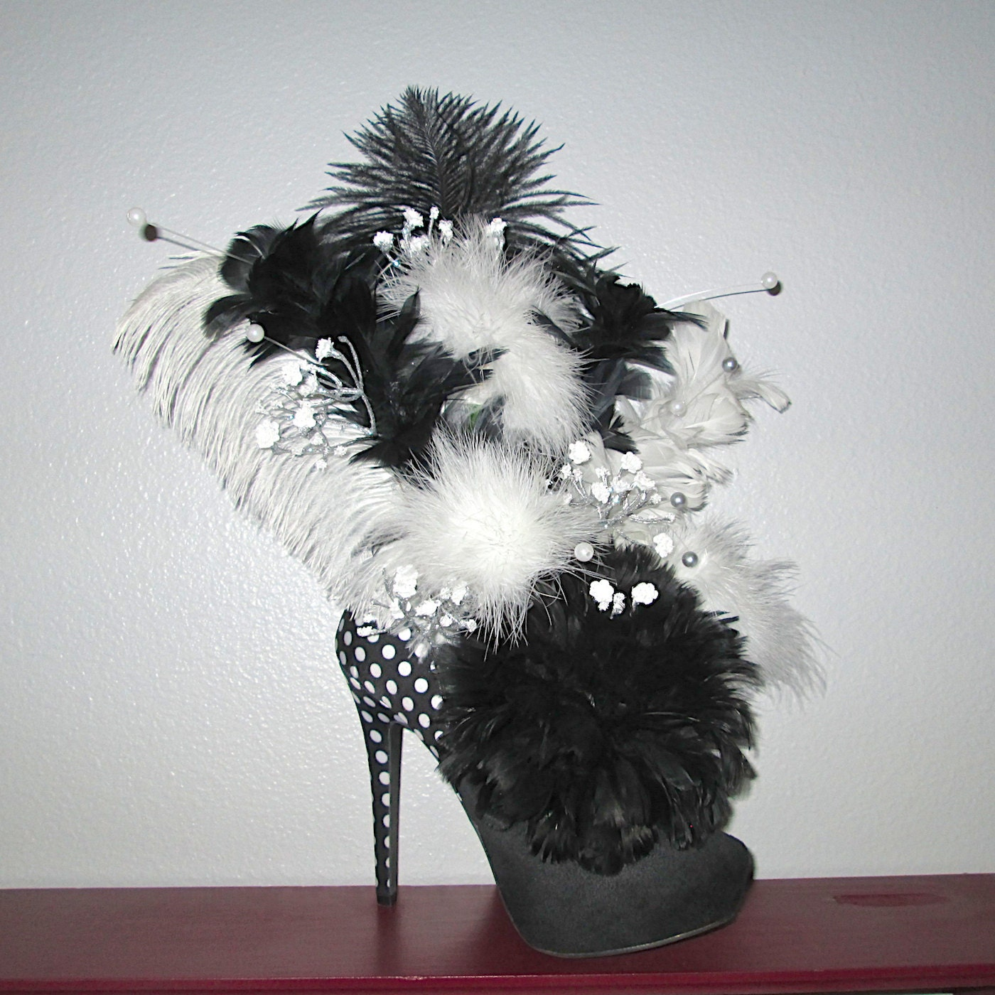 Feather arrangement in a black and white kardashian kollection
