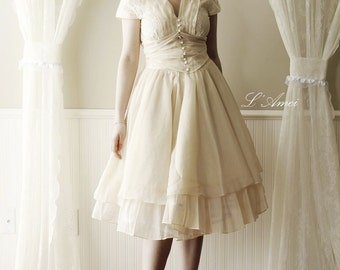 Vintage Style Alice in the Garden Tea Length Wedding Dress featuring Cap Sleeves and Bow.