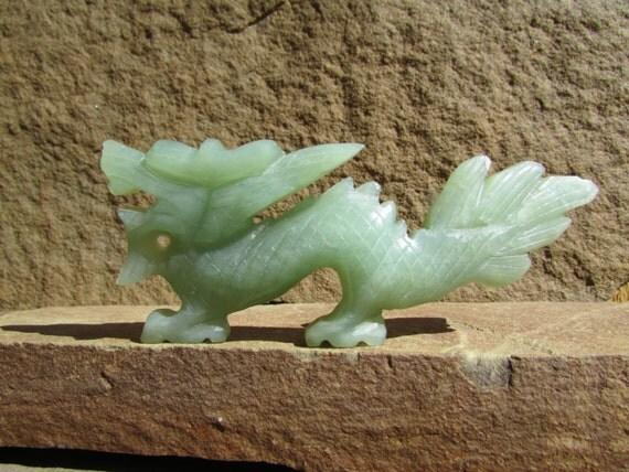 Jade dragon carved green stone figurine