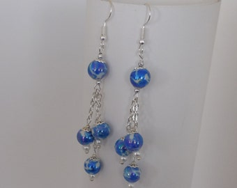 Blues and white dangling earrings