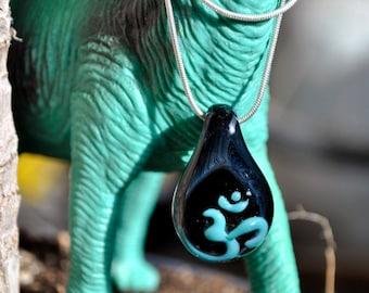 Hand Blown Glass OM / AUM pendant | glass pendant | blown glass black and turquoise galaxy Boro blown glass