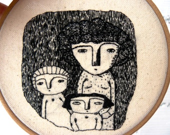 Hand embroidery. Mother with her daughters. Hoop art.