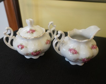 Fancy Ceramic Cream and Sugar Set; Rose Pattern; Approx. 3 x 4 Inches Each;