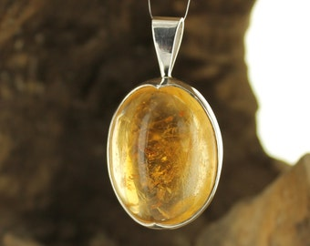 Citrine and silver pendant. Natural stone.